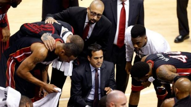 Heat coach Erik Spoelstra speaks to his Miami team in a huddle during the series win over the Indiana Pacers in the ...