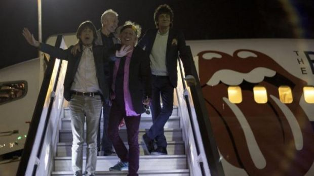Rolling Stones singer Mick Jagger leads the rest of the band down the steps, with Keith Richards, front centre, Ronnie ...