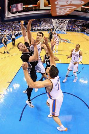 Aron Baynes drives to the basket against Nick Collison and Steven Adams of the Oklahoma City Thunder during San ...