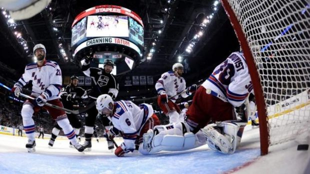 Mike Richards of the Los Angeles Kings celebrates as Henrik Lundqvist  of the New York Rangers gives up the game-winning ...