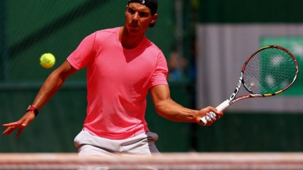 Rafael Nadal of Spain returns a shot during a practice session on day twelve.