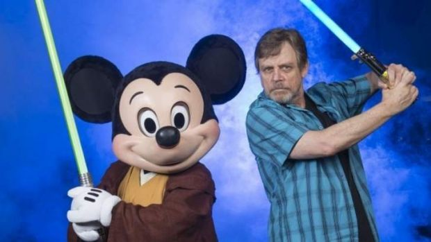 Mickey Mouse and Mark Hamill, the original Luke Skywalker, pose with light sabres to promote a <i>Star Wars</i> weekend ...