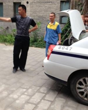 Detained: Australian artist Guo Jian, seen here in the yellow and blue uniform of a detainee, is escorted from his ...