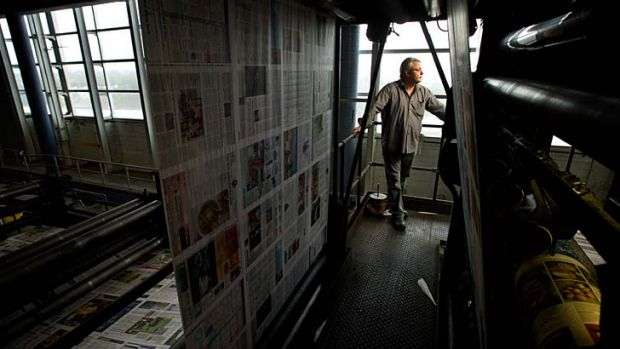 End of an era: Greg Dewstow at the Chullora printing press on its last night of printing. The press will be sold off as ...