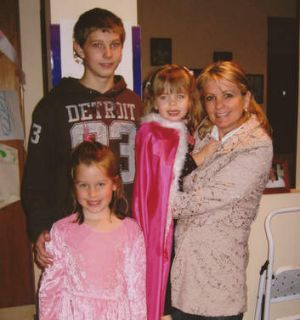 Tyler Cassidy with his mother Shani and two cousins.