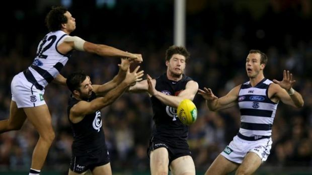 Geelong's Steven Motlop prevents Kade Simpson and Sam Rowe from getting to the ball.