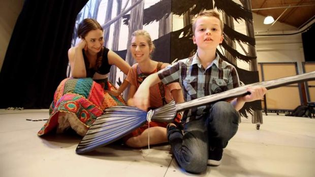 Seven-year-old Ben Hogan, who is on the autism spectrum, with (from left to right) soprano Cristina Russo and ...