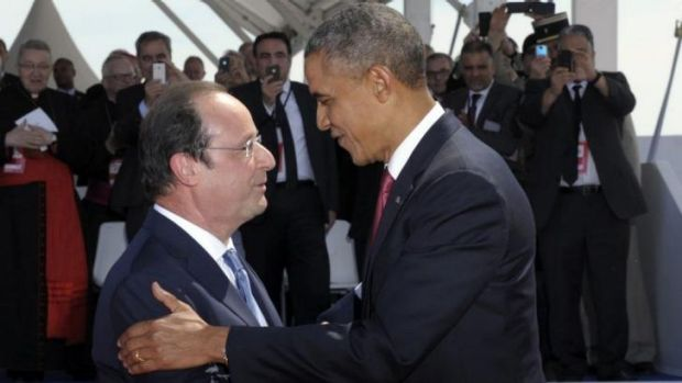 United: French President Francois Hollande greets US President Barack Obama during the D-Day commemoration ceremony on ...