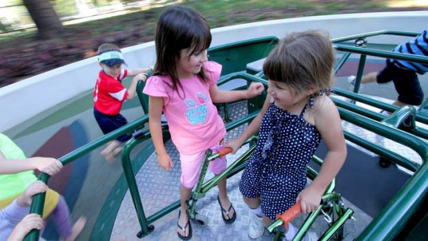 Paige Caruana, 5, enjoys the All-Abilities playground with her sister Taylor Caruana, 7..