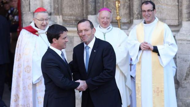 Prime Minister Tony Abbott with French Prime Minister Manuel Valls at the Bayeux Cathedral for a D-Day service in France.