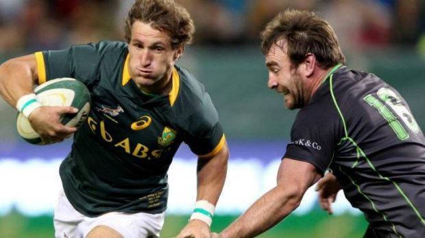 Johan Goosen on the charge for the Springboks.