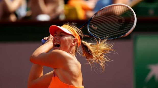 Maria Sharapova returns a backhand to Simona Halep during her French Open final win.