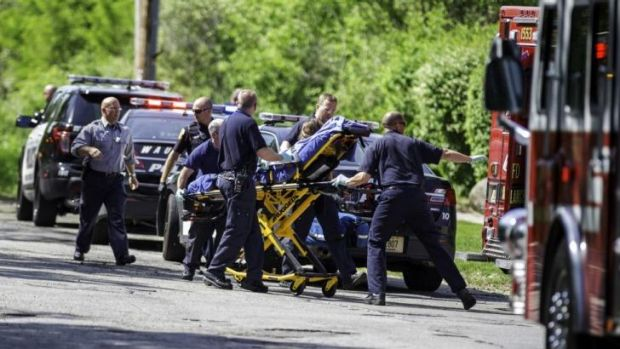 Determined to live: Rescue workers take the 12-year-old stabbing victim to an ambulance in Waukesha, Wisconsin on May 31.