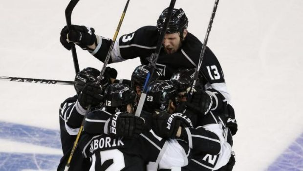 The Kings celebrate Dustin Brown's match-winning goal.