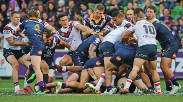 Storm and Roosters players brawl during the round 13 NRL match between the Melbourne Storm and the Sydney Roosters at ...