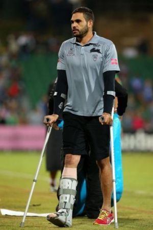Inglis leaves the pitch on crutches.