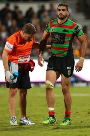 Worry: Greg Inglis is helped form the field in Perth on Saturday night.