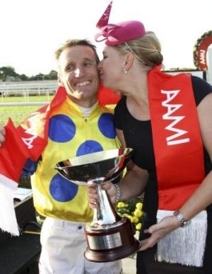 Jockey Damien Oliver gets a peck on the cheek from trainer Natalie McCall for his efforts in the Stradbroke Handicap on ...