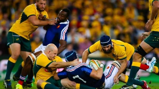 Australian captain Stephen Moore (centre, left) sustains a knee injury whilst tackling French flanker Bernard le Roux ...