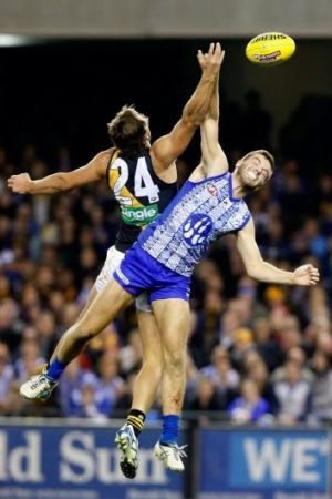 Higher and higher: Ben Griffiths of the Tigers and Luke McDonald of the Kangaroos in an aerial battle for possession.