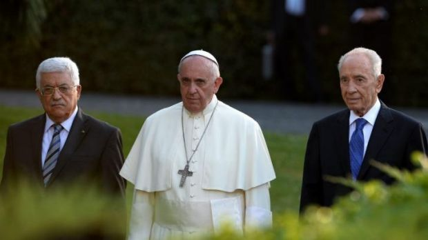 Pope Francis arrives with Palestinian leader Mahmoud Abbas and Israeli President Shimon Peres for a joint peace prayer ...