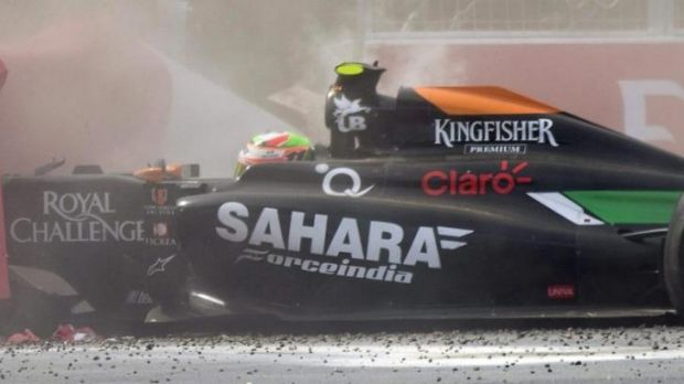 Perez's car slams into the tyre barrier.
