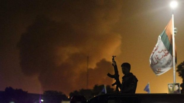 Explosions and gunfire rang out across the airport through the night.