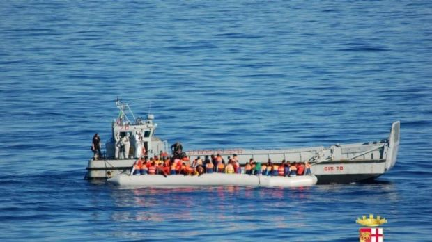 Asylum seekers being rescued by the Italian army off the coast of Sicily.