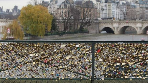 Part of the famous footbridge's railing has collapsed under the weight of the collected love tokens.