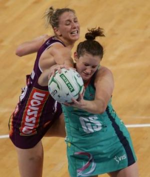 Crunch: Vixens goal shooter Karyn Bailey under pressure against the Firebirds on Monday.