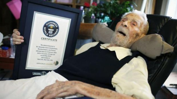 A long and interesting life ... 111-year-old Alexander Imich holds a Guinness World Records certificate recognising him ...