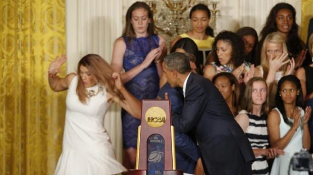 UConn women's basketball star Stefanie Dolson slips on the stage when meeting President Barack Obama.