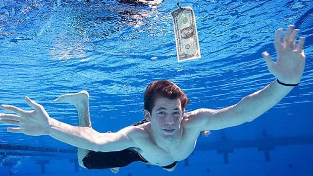 Now an adult, Spencer Eldon strikes a familiar pose recreating the album cover for Nirvana's Nevermind album. For much ...