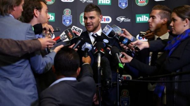 Main focus: Josh Dugan is surrounded by reporters at Tuesday's team announcement.