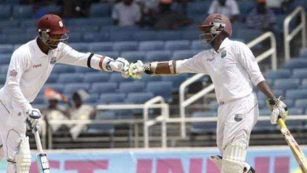 Denesh Ramdin, left, and Shivnarine Chanderpaul try to hold the West Indies innings together.