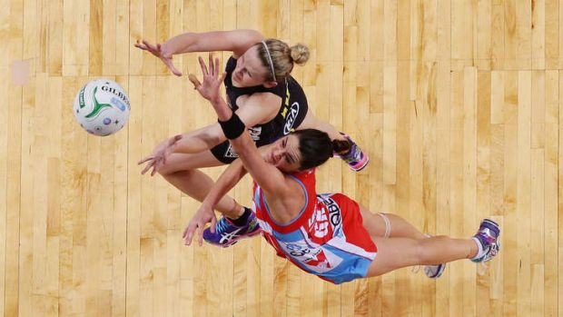 Jo Harten of the Magic, top, competes with Sharni Layton of the Swifts during the ANZ Championship minor semi-final on ...