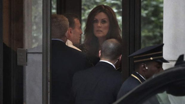 Prime Minister Tony Abbott and his chief-of-staff Peta Credlin arrive in the lobby of Rupert Murdoch's Central Park ...