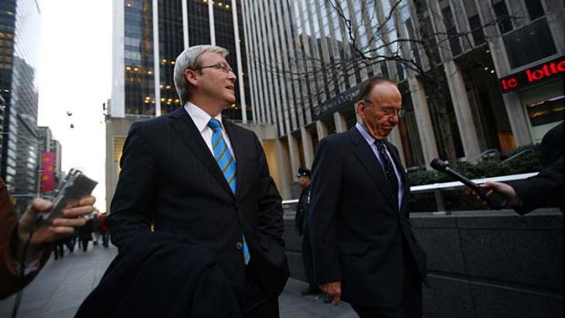 Then opposition leader Kevin Rudd pictured leaving the News Corporation building with Rupert Murdoch after a meeting in ...