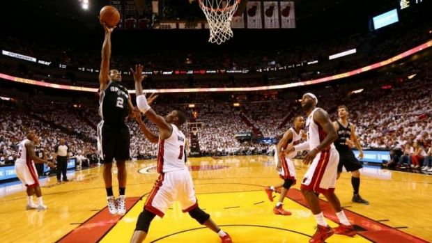 Hot hand ... Kawhi Leonard of the San Antonio Spurs takes a shot over Chris Bosh during game 3.
