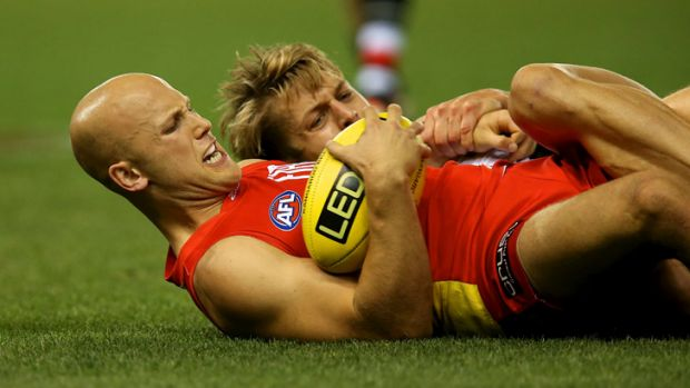 Give me a hand: Gary Ablett battles Sean Dempster of St Kilda for possession.