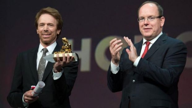 Prince Albert II of Monaco (R) applauds after delivering the lifetime achievement award to US film and TV producer Jerry ...