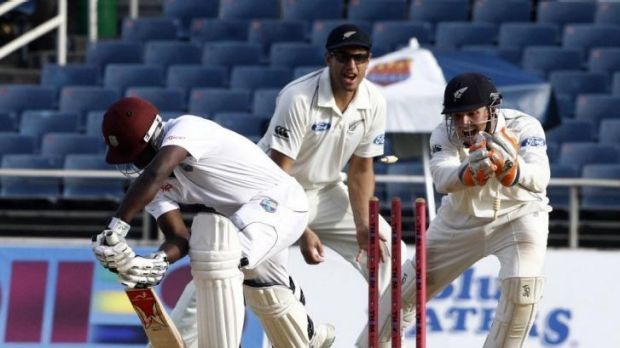 Kiwi 'keeper BJ Watling attempts to stump West Indies tailender Kemar Roach.