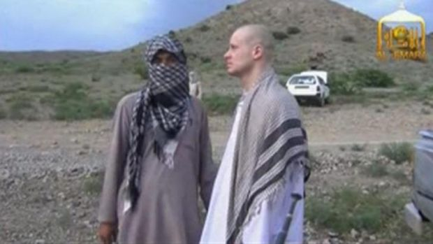 Bowe Bergdahl waits before being released at the Afghan border.