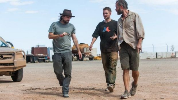 Dirty old town: Director David Michod (left) on the set of <i>The Rover</i> with Robert Pattinson (middle) and Guy Pearce.