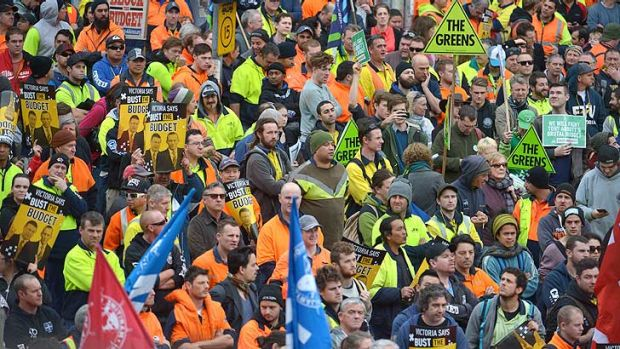 Union members rally in Melbourne against the Federal Government's budget.
