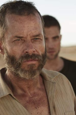 Guy Pearce, front, and Robert Pattinson in <I>The Rover.</i>