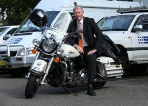 Black Dog Ride. Channel 9 reporter Simon Bouda and his Harley Davidson. Simon will ride around Australia to raise money ...