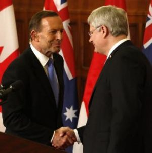 Soulmates: Prime Minister Tony Abbott shakes hands with Canadian Prime Minister Stephen Harper.