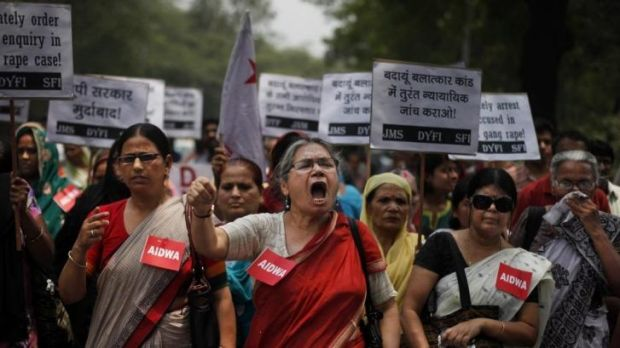Members of the All India Democratic Women's Association take to the streets to protest after the rape and murder of two ...