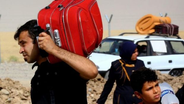 Refugees fleeing from Mosul head to the self-ruled northern Kurdish region in Erbil.